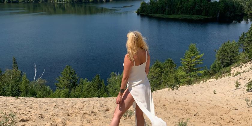 Woman on a lake shore