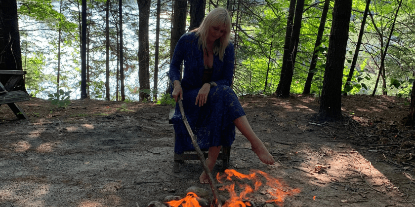 Woman beside a fire